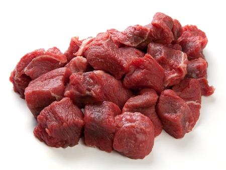 carne de res: Carne en dados o en cubos de carne cruda Foto de archivo