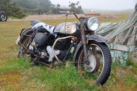 rusting: Rusting motorcycle left to rot Stock Photo