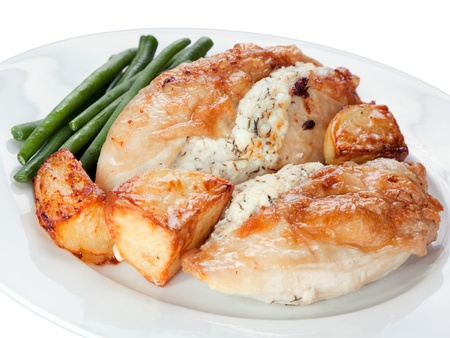 Pan fried chicken in a garlic suace with roast potatoes and green beans
