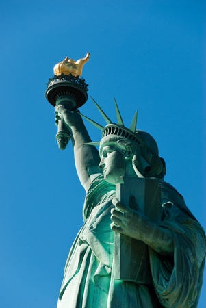 Statue of Liberty with blue sky background photo