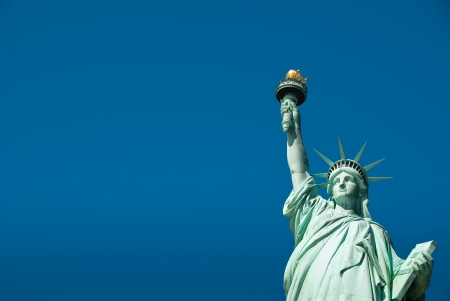 liberty torch: Statue of Liberty with blue sky background