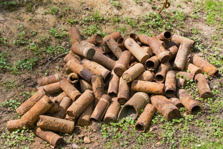 artillery shell: Rusting shell cases left over from the First World War. These are still being found by farmers whilst ploughing and need to be checked by bomb disposal experts.