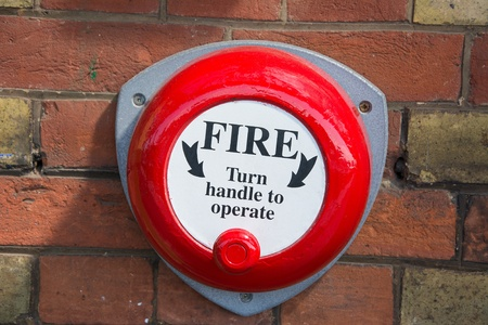 operated: Old fashioned hand operated fire alarm bell