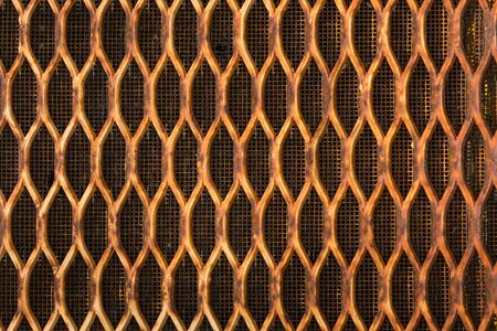 Corroded tractor radiator grille. Stock Photo