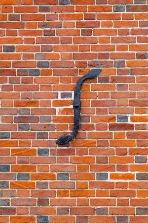 bowing: S-iron reinforcing plate to tie in a bowing wall Stock Photo