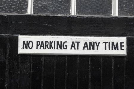 No Parking on a black painted garage door