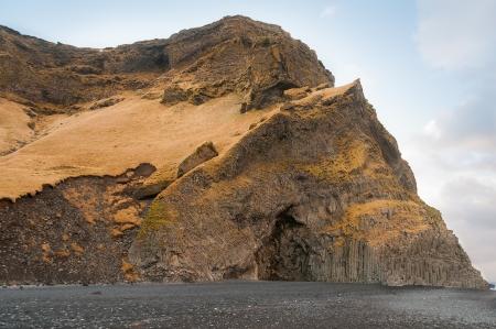 View of Reynisfjara rock formations on the beach at Halsanefhellir Iceland