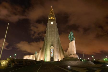 leif: Hallgrimskirkja church Reykjavik Iceland taken at night with Lief Ericksson statue Stock Photo
