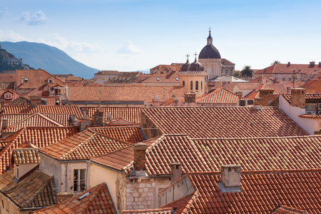Rooftop view of Dubrovnik with church and clock tower Stock Photo