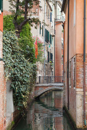 Typical street scene of canal in Venice Italy