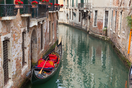 backstreet: Venetian backstreet canal with empty gondola