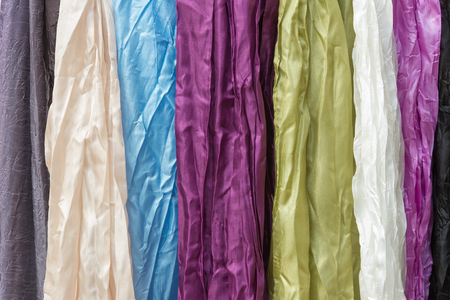 Colorful silk scarves hanging vertically Stock Photo