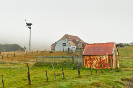 self sufficient: Corrugated iron outbuildings and wind turbine