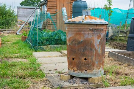 incinerator: Outdoor incinerator for allotment or garden Stock Photo