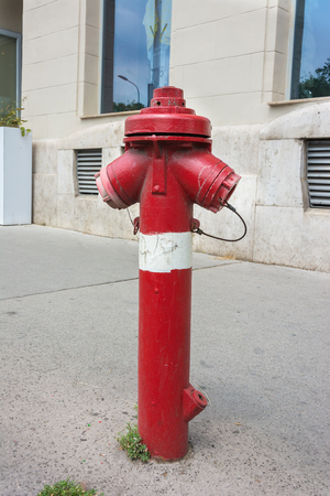 Fire hydrant with two hose outlet on an urban street photo