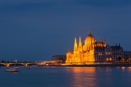 Parliament building Budapest at twilight over the river Danube photo