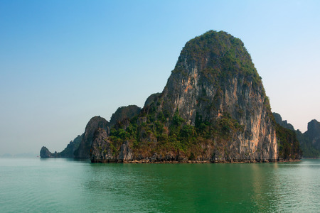 Veiw of Halong Bay Vietnam a UNESCO heritage site with tourist boats. photo