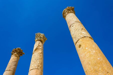 umm: Ancient ruin at Umm Qais in Jordan closeup of pillars
