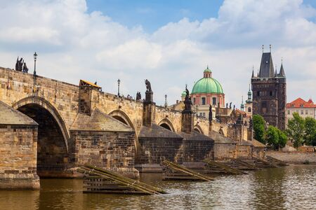 st charles: View of Charles Bridge in Prague showing the tower and St Francis church Stock Photo