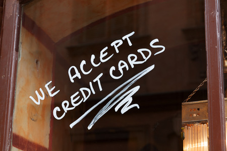 Hand painted shop window sign for accepting credit cards