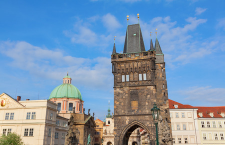 francis: View of the Tower on Charles Bridge in Prague with the church of St Francis in the background