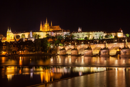gothic church: View at night across the Vltava River in Prague with Charles Bridge and the Castle