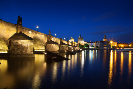 francis: View at night across the Vltava River in Prague with Charles Bridge St Francis Church Editorial