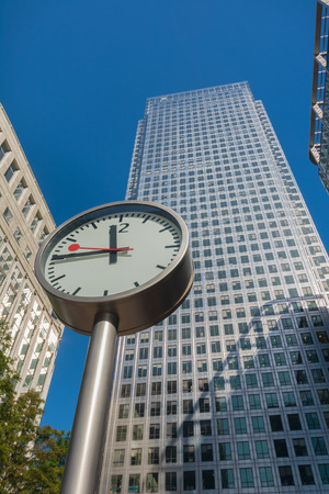 Clock and skyscrapers at Canary Wharf, Docklands the heart of the financial district of London