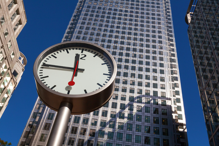 Clock and skyscrapers at Canary Wharf, Docklands the hert of the financial district of London