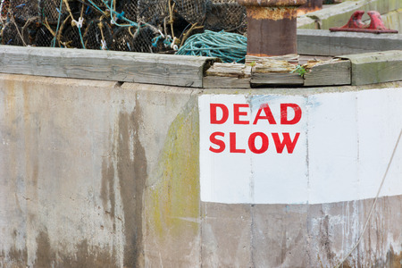 Dead Slow speed warning at harbour entrance