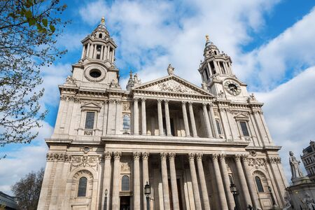 St Pauls Cathedral in London, against a cloudy blue sky. Showing the front facade by Sir Christopher Wren.