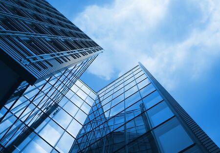 Tall office building with blue tint to whole image Stock Photo