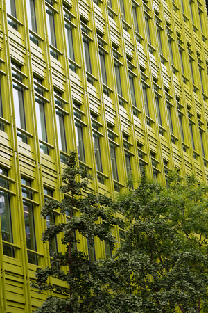Green fronted office building in a city Banco de Imagens - 67735020
