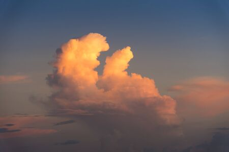 Evening sky with dramatic clouds over the sea with sculpted 3D cloudscape.