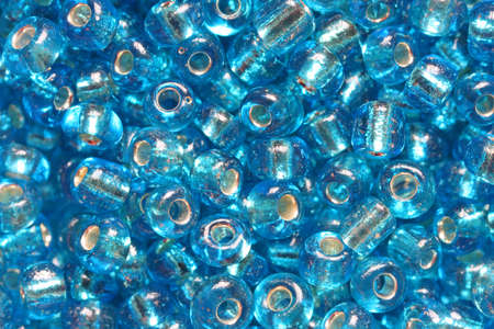 the trappings: Aqua blue beads, supermacro