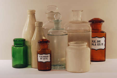 Group of antiques glass flasks and stoneware pots
