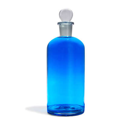 antiquary: Antique pharmacy flask with blue colored liquid Stock Photo