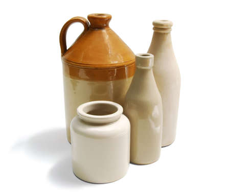 A group of old and decorative stoneware containers 23 Stoneware Containers Stock Photo