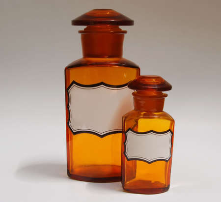 21 Antiques Flacks Two antique pharmacy flasks in brown glass with porcelain tags