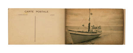 18 Postcard Album    Old postcard album with picture of a fishing boat  Stock Photo