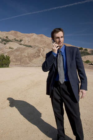 cel: Man on his cell phone in the desert