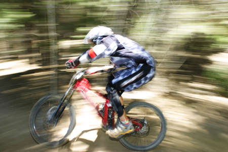 Downhill mountain bike racer Stock Photo