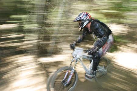 v cycle: Downhill mountain bike racer Stock Photo