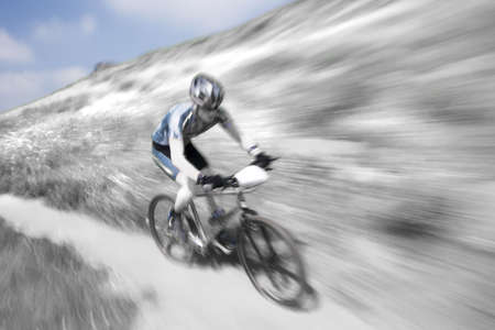 Competitor in a downhill mountain bike race Stock Photo