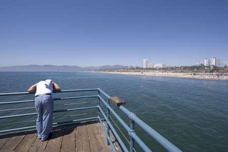 deficient: man standing on the Santa Monica pier
