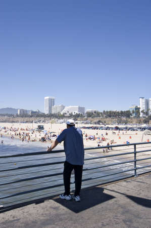inadequate: man standing on the Santa Monica pier
