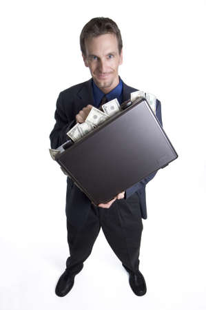 Businessman with briefcase overflowing with money