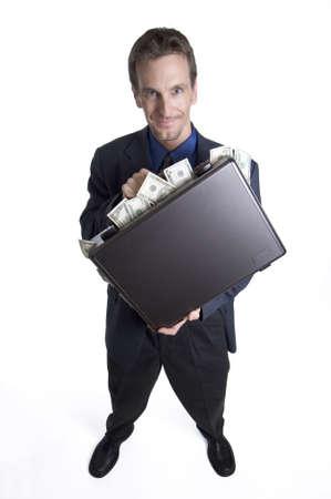 remuneraci�n: Hombre de negocios con la cartera que desborda con el dinero Foto de archivo