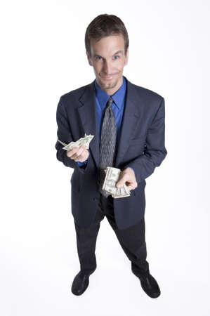 remuneraci�n: Hombre de negocios que cuenta el dinero Foto de archivo