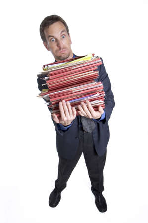 Overworked businessman tipping over from carrying too many folders photo